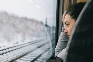 Traveling thoughts - woman watching through the train window