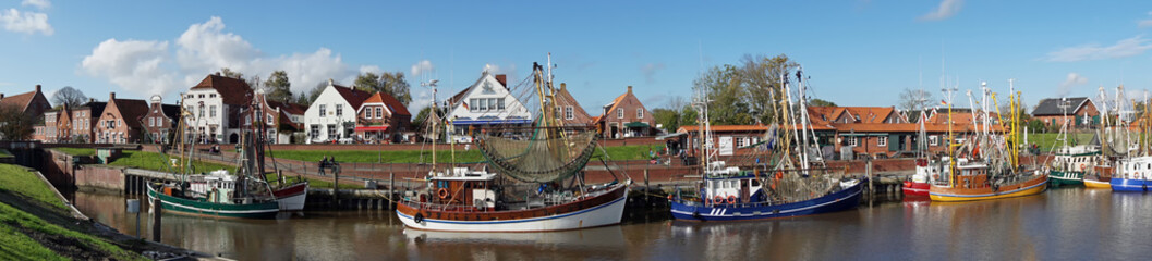 Fleet of fishing boats/crab cutters in the port of Greetsiel, Germany