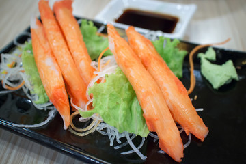 fresh crab stick with vegetables decorative on plate