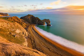 Aluminium Prints Sea Gorgeous golden light at the famous Durdle Door on the Jurassic Coast, Dorset, UK.