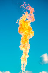 gas flame on a blue sky