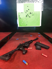Picture of shooting gallery with target, gun