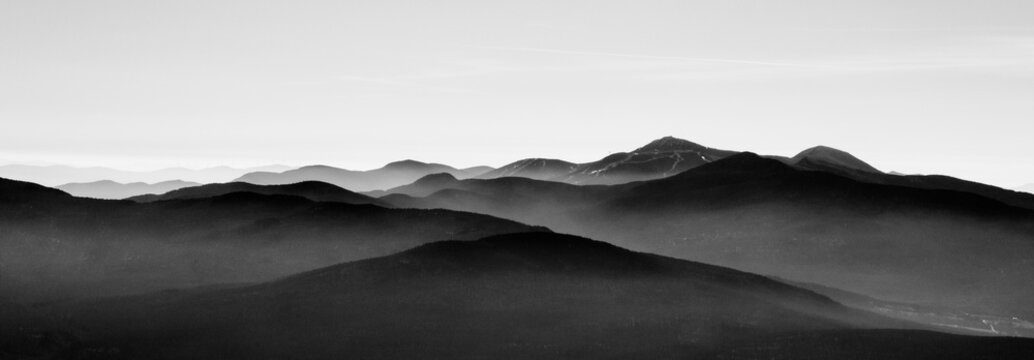 Mountain landscape in sutton, black and white with mist on background