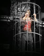 Monster plastic man inside an iron cage