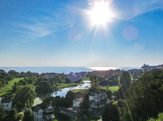 Mackinac Island in Northern Michigan, USA. Summer panoramic view with blue sky and bright sun rays.