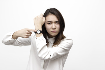 Portrait of pretty angry disappointed woman with wrist watch showing and remiding about time. Hurry up pointing on watch concept