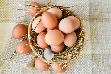 fresh farm chicken egg in the basket on textile background, preparation for Easter