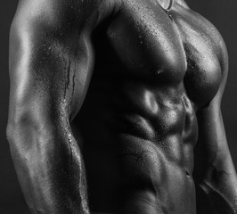 Sexy body part of male fitness model