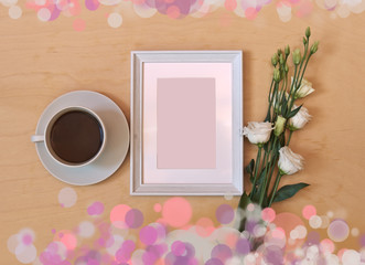 Cup of coffee, picture frame and white eustoma flower