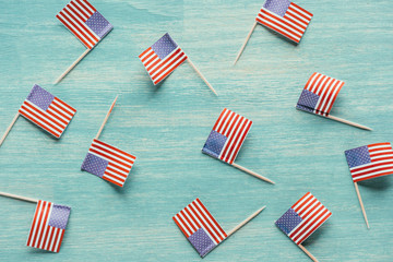 top view of arranged american flags on blue wooden surface, presidents concept