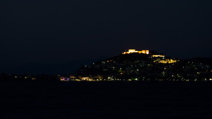 Night scene of Astros town with old castle Greece