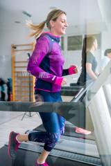 Beautiful woman in gym