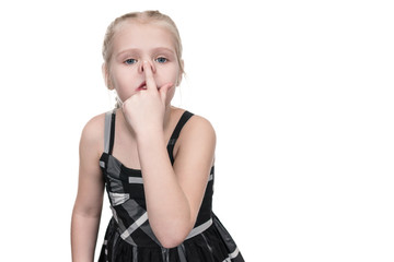 Little girl grimaces pushing on her nose isolated on white background