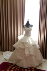 White wedding dress gown on mannequin. Bride's morning wedding preparation concept