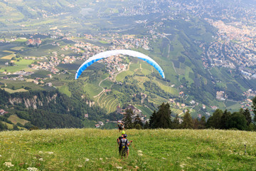 Paragliders start Paragliding in front of Merano panaroma in South Tyrol