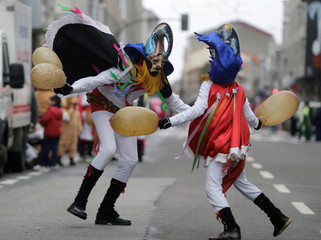 Revellers strike each other with pig bladders on a street during carnival celebrations in the northwestern village of Xinzo de Limia