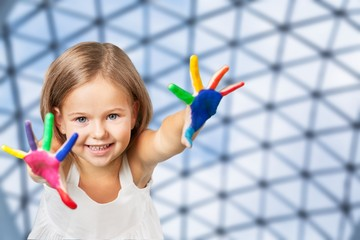 Hands painted children on blurred background