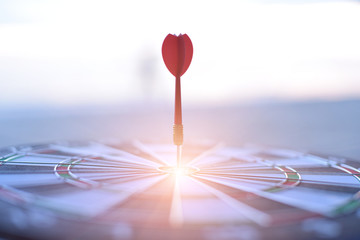 Dart is an opportunity and Dartboard is the target and goal. So both of that represent a challenge. Bulls eye and Dart. opportunity, risk management, business concept .