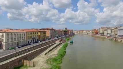 Wall Mural - Homes of Pisa along Arno river in summer season, aerial view
