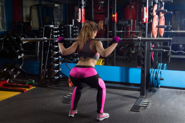 Fitness girl and a barbell.