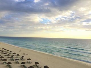 Caribbean ocean white sand beach sunrise in Cancun, Mexico