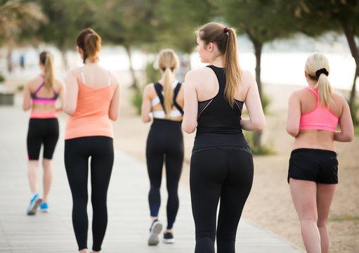 Positive young girls during racewalking training