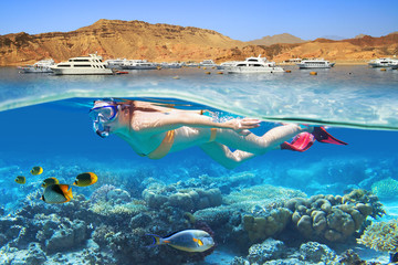 Young woman at snorkeling in the tropical water