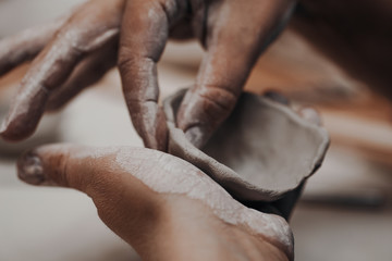Female potter works with clay, craftsman hands close up Fototapete