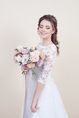 Beautiful female model with perfect fashion makeup and hairstyle. Elegant female hairstyle for the wedding.
