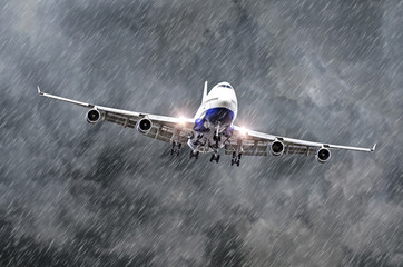 Large passenger airplane approaches the landing at the airport of rain, bad weather.