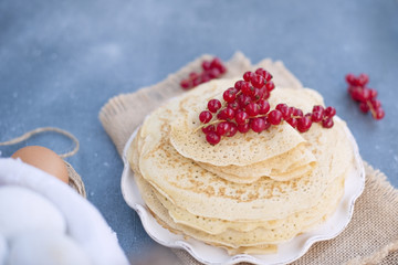 Thin sweet pancakes. traditional Russian food in the spring. Festive treat. Homemade breakfast. Free space for text or a postcard.