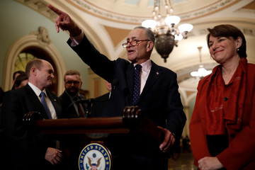 Senate Minority Leader Chuck Schumer, accompanied by Sen. Chris Coons (D-DE) and Sen. Amy Klobuchar (D-MN), speaks with reporters following the weekly policy luncheons at the U.S. Capitol in Washington