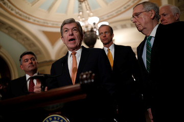 Sen. Roy Blunt (R-MO), accompanied by Sen. Cory Gardner (R-CO), Sen. John Thune (R-SD), and Senate Majority Leader Mitch McConnell, speaks with reporters following the weekly policy luncheons at the U.S. Capitol in Washington