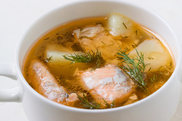Salmon soup in a saucepan.