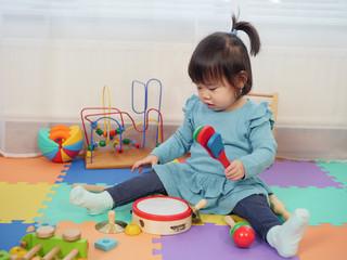 baby girl play clacker at home