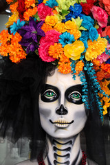 Lovely and colorful catrina with bright flowers up her head