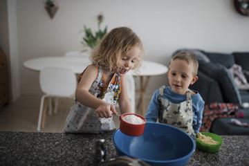 Siblings preparing food at home