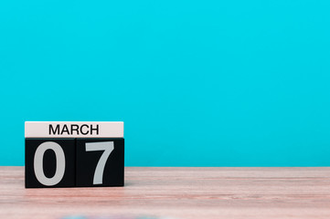 March 7th. Day 7 of march month, calendar on turquoise background. Spring time, empty space for text, mockup