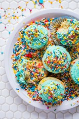 Cupcakes with turquoise icing and rainbow sprinkles