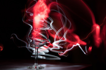 Abstract Wine Glass with Red and White Smoke