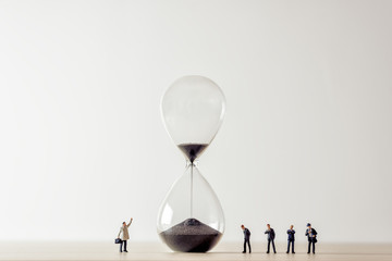Conceptual image of business people looking at Hourglass