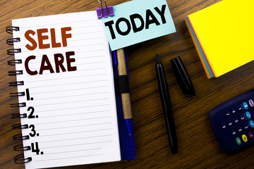 Word, writing Self Care. Business concept for Taking caring for own Health written on book note paper on the wooden background. With attached today sign. Office top view.