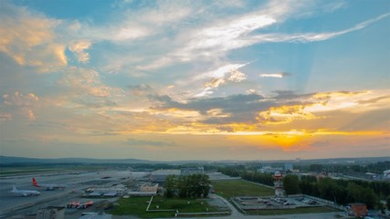 Time lapse of airport exterior and clouds moving fast in the sky. Video. Time lapse of sunset over an airport, HDR imaging high dynamic range