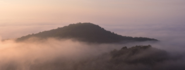 Foggy landscape in morning with mountains