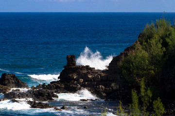 Volcanic rock and Pacific surf on the coast of Maui, Hawaii