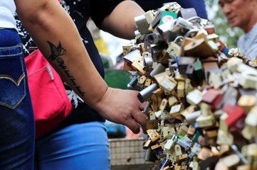 """A passerby looks at """"Love Lock"""" fence, the symbol of undying love with God, near the National Shrine of Our Mother of Perpetual Help in Paranaque city, as part of Valentine's Day celebrations, Metro Manila"""