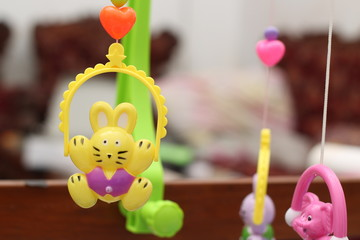photo of plastic toys, doll-shaped