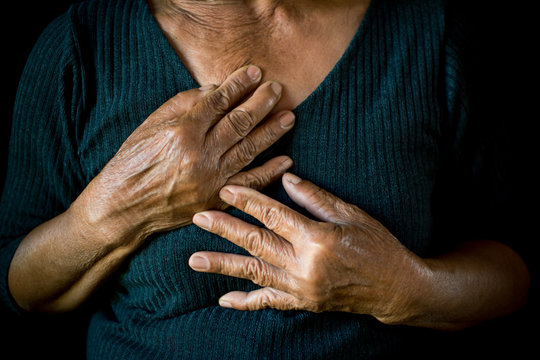 Old woman felt heart ache on black background,Illness of the elderly problem concept