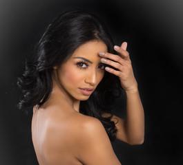 Beautiful woman turning head bare shoulders
