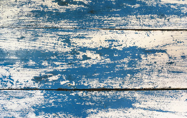 Grunge texture : Old wooden table painted with blue and white color, some color peeled off created unique texture.